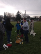 Lansing Soccer Club Director Bruce Winters delegating tasks to volunteers.