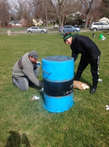 Parents of Soccer Club in the process of beautifying the trash cans.
