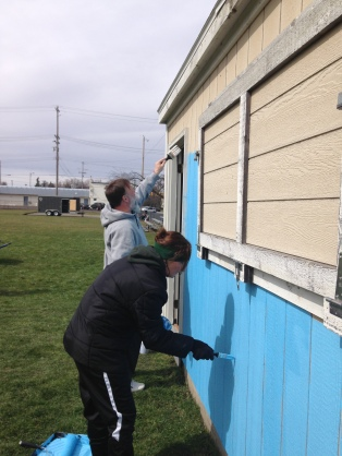 Parents of the Soccer Club beautifying the equipment shed.