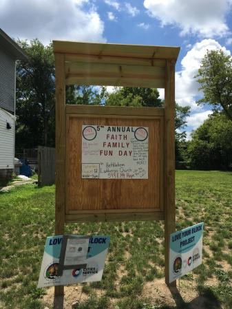 A Family Fun Day notice on a community message board in Baker Neighborhood.