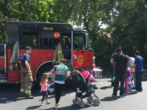 Families explore a fire truck at the Baker Family Fun Day