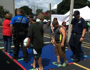 Children and Police playing games at Baker Family Fun Day